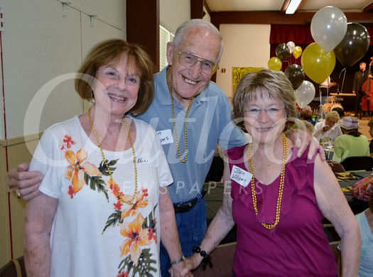 "Ellie Wildermuth (left) and Joan Williams help Don Williams celebrate his 86th birthday at the""Swingin' Seniors"" event at the Community Center"