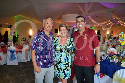 Booster President Jeremy Milbrodt with event co-chairs Robin George and Ken Mueller