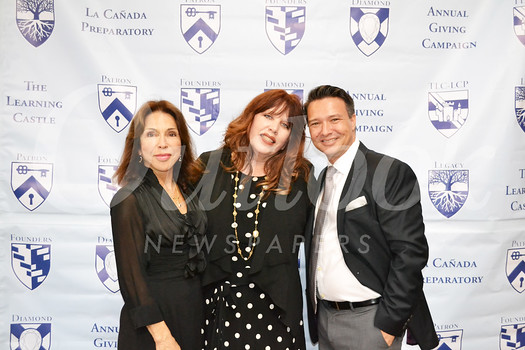 Founder and Director Terry Villanueva, Diamond Service Award honoree Joy Gillman and Assistant Director Justin Whalin