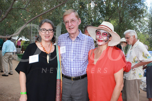 Mayita Dinos, board President George Brumder and Executive Director Michelle Matthews