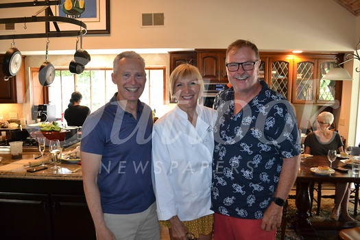 Host John Lewis, event organizer Kathy Gibson and Stars representative Curt Gibson