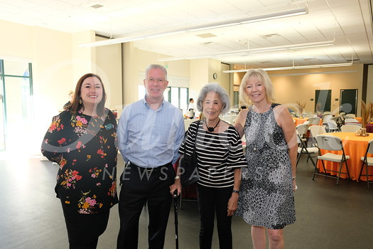 Vice President of Development Kristina Lamas, Humane Society board chair Steve Johnson, Grace Anderson and interim President Ruthie Hughes