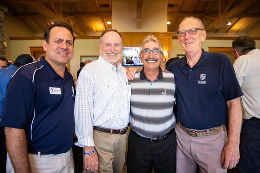 La Salle's Vice President of Development Kevin Delaney, interim President Patrick Bonacci, golf tournament honoree Harry Agajanian and Lancer Golf Classic volunteer coordinator Don Olender
