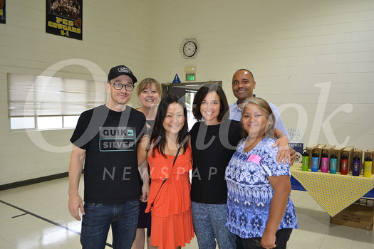 Matt and Janet Wilson (front row, from left), Leslie Glass and Sonia Silao Mercado. Back: Melanie Sauer and Lamont Smith