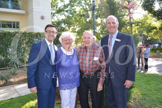 Villa Gardens Executive Director Dmitry Estrin, Resident Association President Nancy Bechtolt, honorary historian Jim Haight and Front Porch CEO John Woodward
