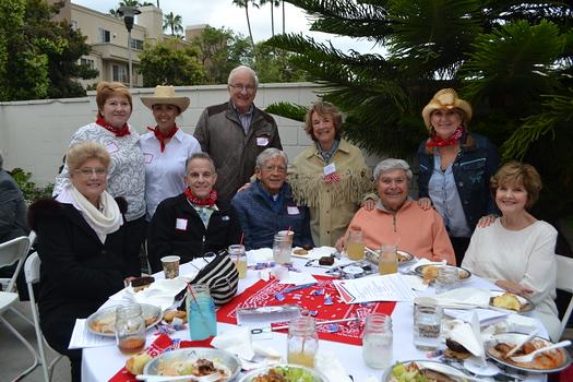 Valerie Kalik (front row, from left), Sean Kennally, Jim Brown, Sal and Bobbi Gangi. Back: Barbara Gilliam, Lisa Mena, Jan Kalik, board member Merrilyn Brown and Connie Adams.