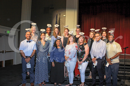 This year's winners of the Huntington Middle School Halo Awards include Dika Firmansyah (front row, from left), Michele Canon, Sri Abboy, Lisa Begerow, Laura MacDonald, Vincent Tricarico and Mike James. Back: Principal Alana Fauré, Dean Jackson, Alexis Anvekar, Melissa Short, Penny Roberts, Claudia Boles and Grace Karkafi. The HMS PTA bestows the annual awards in recognition of school staff and parents for their outstanding contributions during the year.